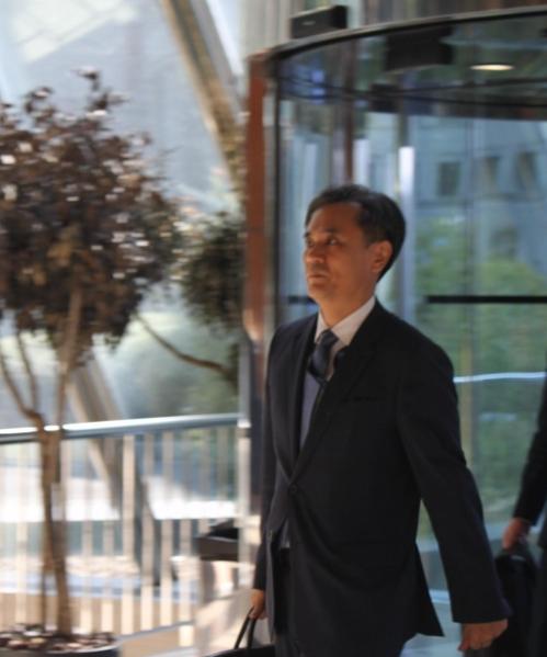 当地时间7月24日,金胜镐走入世贸组织总理事会会场。 韩联社