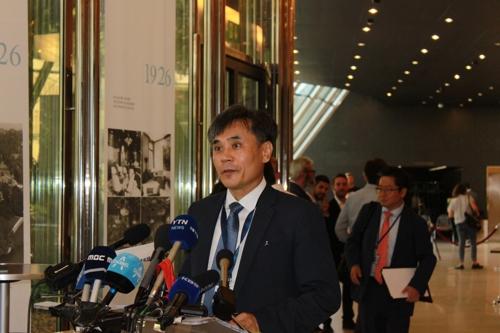 当地时间7月24日,金胜镐在世贸组织总理事会会议结束后召开记者会。 韩联社