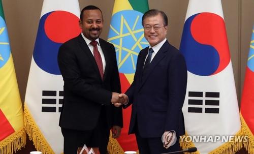 文在寅会见埃塞俄比亚总理阿比