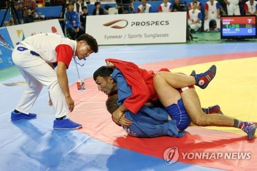 资料图片:桑搏比赛照 韩联社