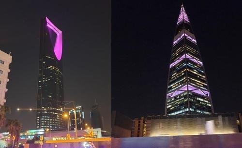 当地时间10月10日,沙特阿拉伯首都利雅德著名的王国塔(左)和费萨尔塔打出紫色灯光,欢迎防弹少年团到访。 韩联社