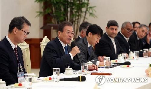 文在寅接见韩联社等亚通组织成员社代表