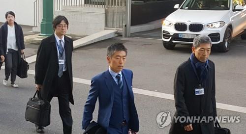 当地时间11月19日上午,在日内瓦,日本代表团到达世贸总部。 韩联社