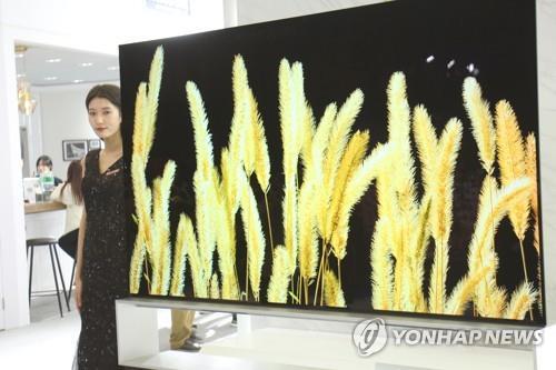 资料图片:三星QLED电视 韩联社