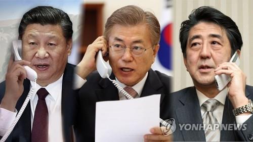 资料图片:左起依次为习近平、文在寅和安倍晋三 韩联社