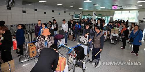 资料图片:襄阳国际机场入境大厅 韩联社