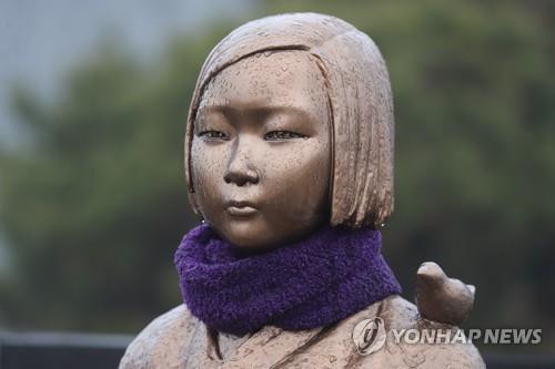 资料图片:和平少女像 韩联社
