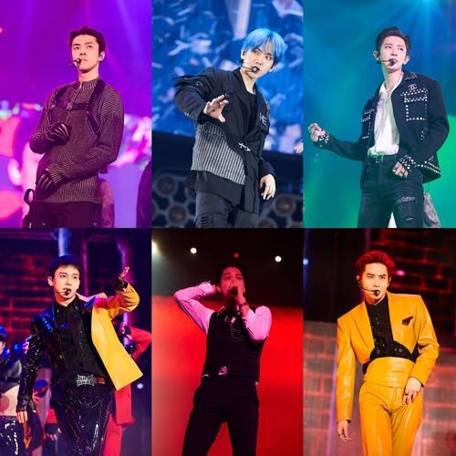 资料图片:EXO成员们在演唱会现场 SM娱乐供图(图片严禁转载复制)