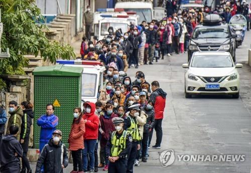 韩驻沪领馆向侨民分发3万只口罩