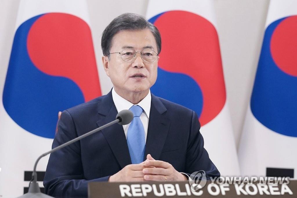 5月18日,在青瓦台,韩国总统文在寅在世界卫生大会视频会议上发表讲话。 韩联社/青瓦台供图(图片严禁转载复制)