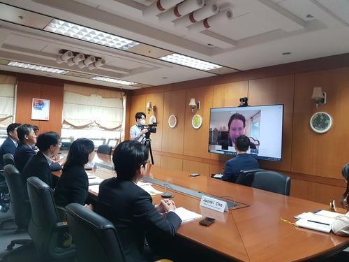 韩国在线与美共享选举防疫经验