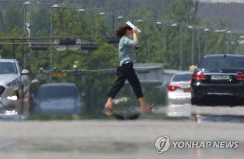 韩国多地发布高温预警