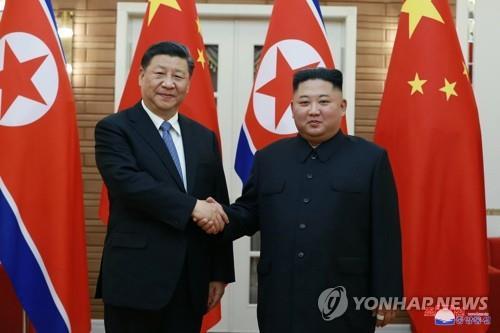 朝媒纪念金习会一周年强调朝中友谊