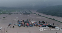 韩政府将7个市郡划为暴雨特别灾区