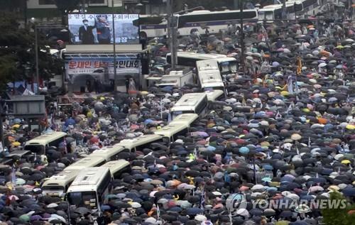 韩政府拟限制近期集会严打违规行为