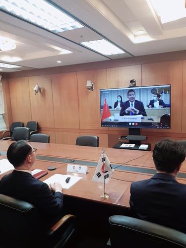 韩中外交高官举行视频会议共商合力抗疫