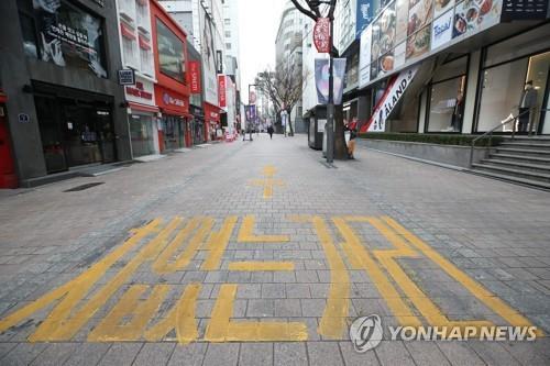 资料图片:明洞街头空无一人 韩联社