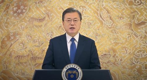 资料图片:12月13日,文在寅在气候雄心峰会上通过视频发表重要讲话。 视频截图(图片严禁转载复制)