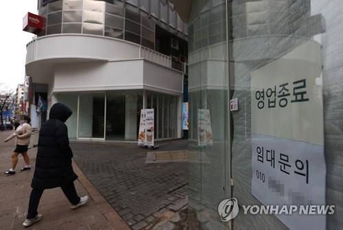 资料图片:首尔明洞 韩联社