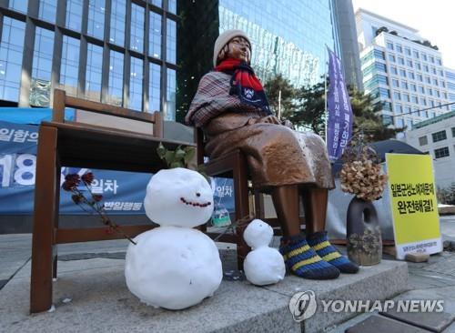 韩籍慰安妇对日索赔胜诉判决有望23日生效