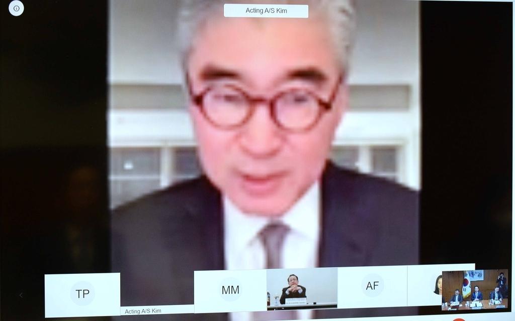 韩美日外交高官视频会议照 韩联社/外交部供图(图片严禁转载复制)