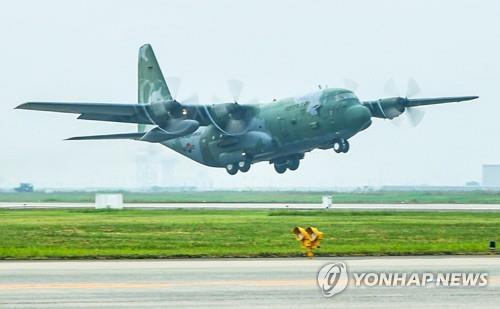 资料图片:军用C-130运输机 韩联社