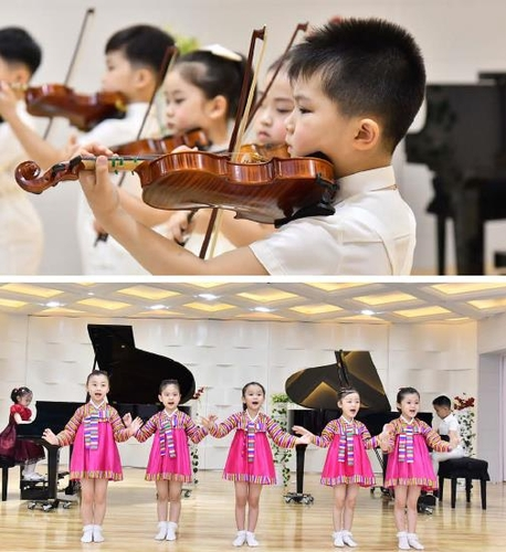 朝鲜平壤市庆上幼儿园课堂 画报《朝鲜》(图片仅限韩国国内使用,严禁转载复制)