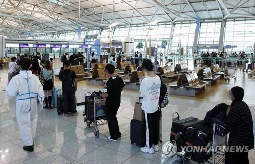 资料图片:仁川机场国际出发大厅 韩联社