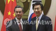 韩中外长通电话谈落实联合国安理会涉朝决议