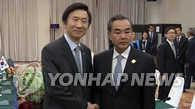 韩中外长老挝会晤谈萨德问题