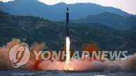 朝军称正研究瞄准关岛周围发射中程导弹