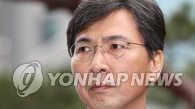 韩前忠南道知事再次就性侵案到案受讯