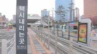 资料图片:韩10万出租车司机罢工抵制拼车软件。
