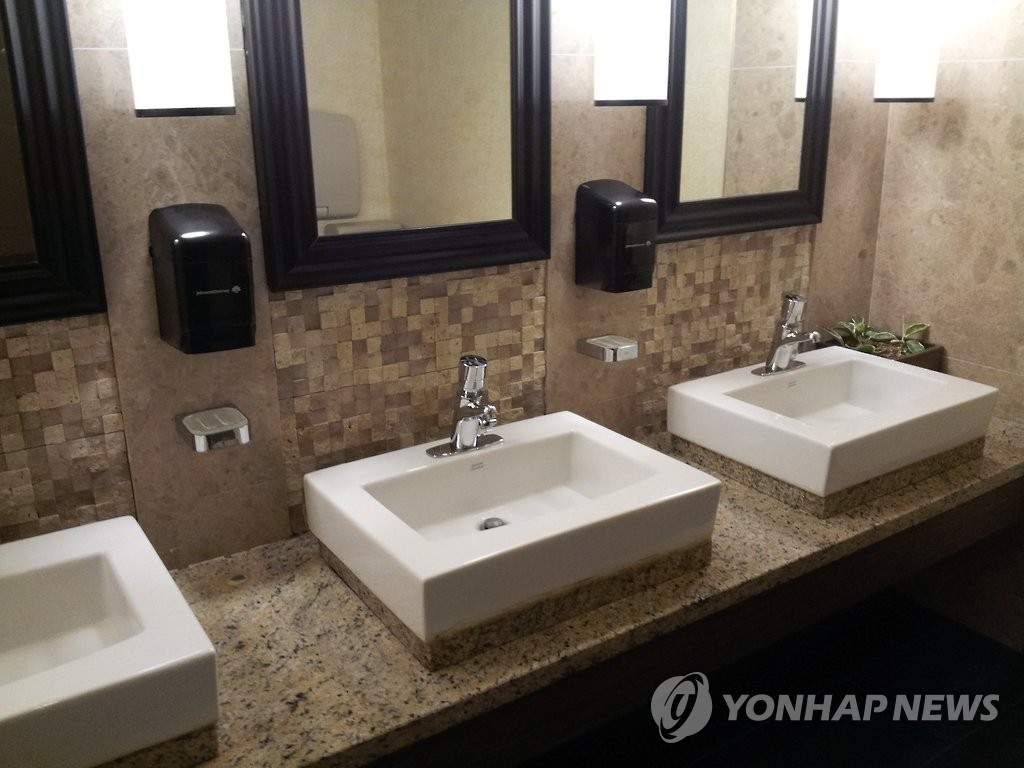 资料图片:洗面盆 韩联社