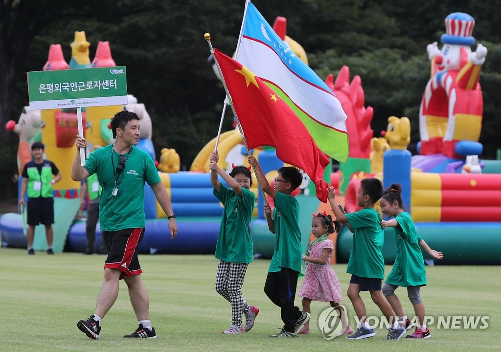 """在韩外国劳动者办""""奥运"""""""