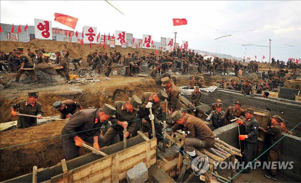 朝媒公开抗洪救灾工作现场