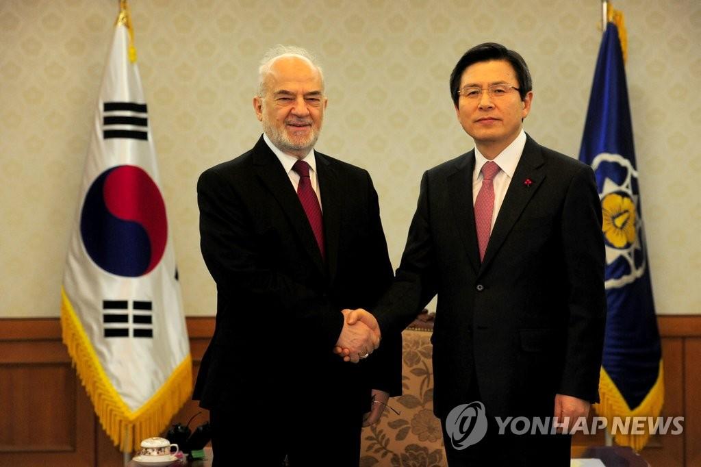 韩代总统会见伊拉克外长