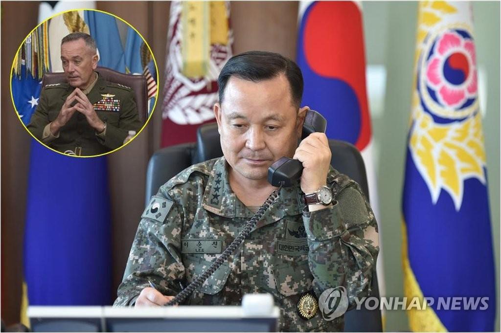 资料图片:右为韩国联参议长李淳镇,左为美国参谋长联席会议主席约瑟夫•邓福德。(韩联社/韩国联参提供)