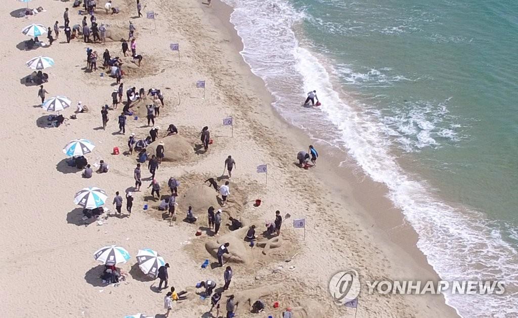 资料图片:釜山海云台沙滩(韩联社)