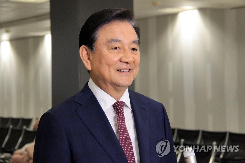 韩总统特使洪锡炫(韩联社)