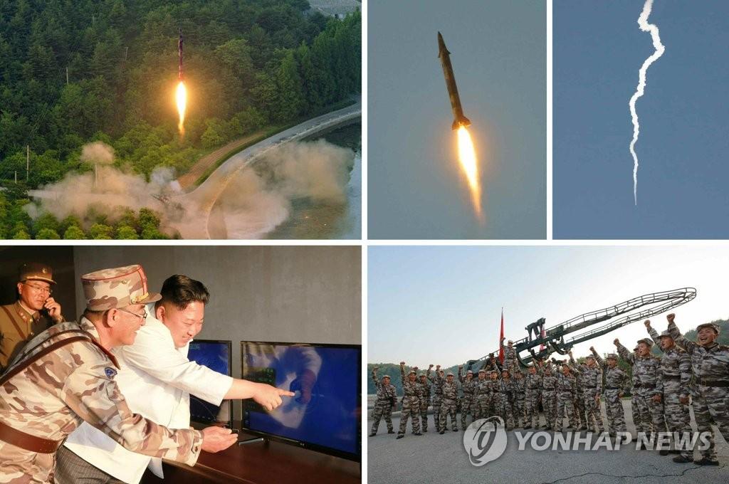 朝鲜《劳动新闻》30日报道金正恩视察朝鲜试射弹道导弹。图片仅限韩国国内使用,严禁转载复制(韩联社/朝中社)