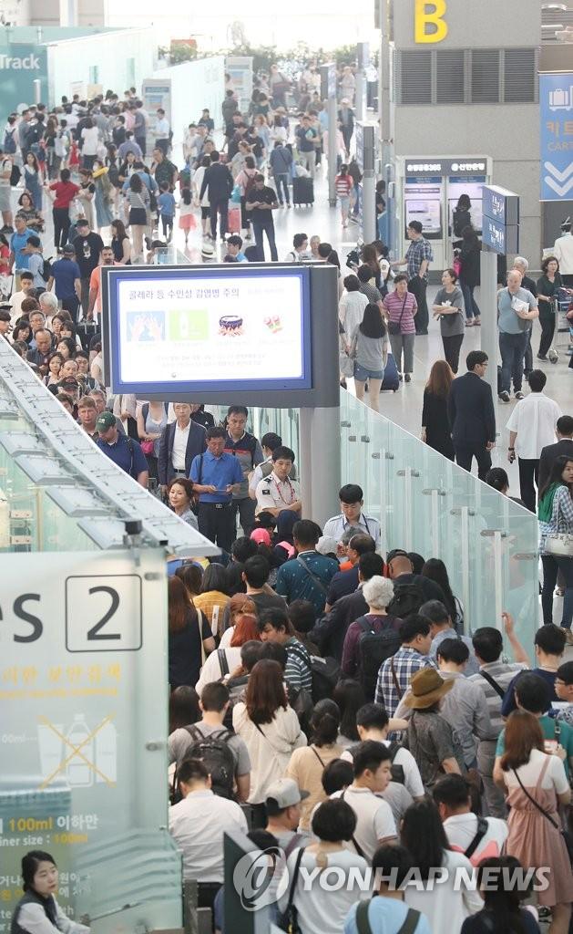 韩国游客涌向国外