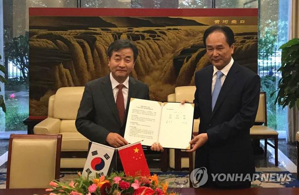 韩联社新华社签共办图片展协议
