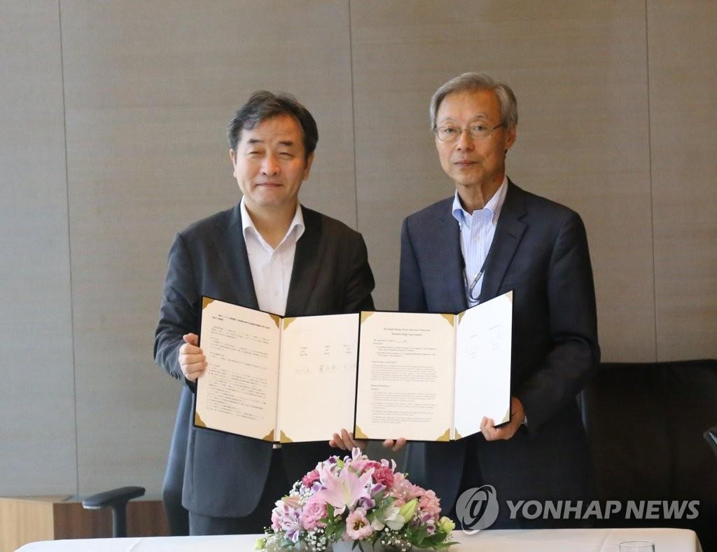 韩联社共同社签共办图片展协议