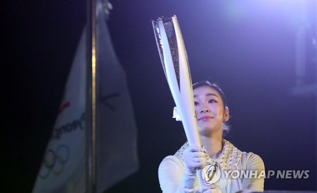 金妍儿点燃奥运圣火