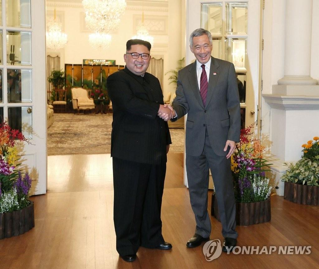金正恩会见新加坡总理李显龙