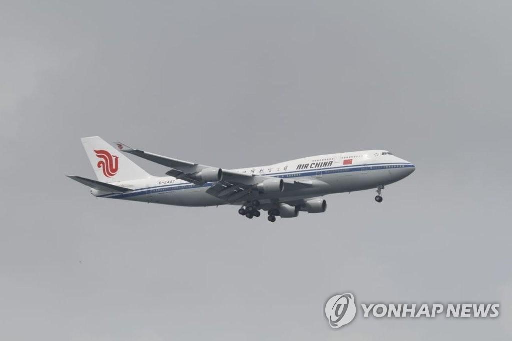 金正恩乘中国国航专机飞新加坡