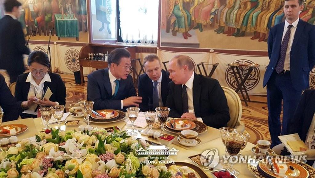 韩俄领导人晚宴花絮照