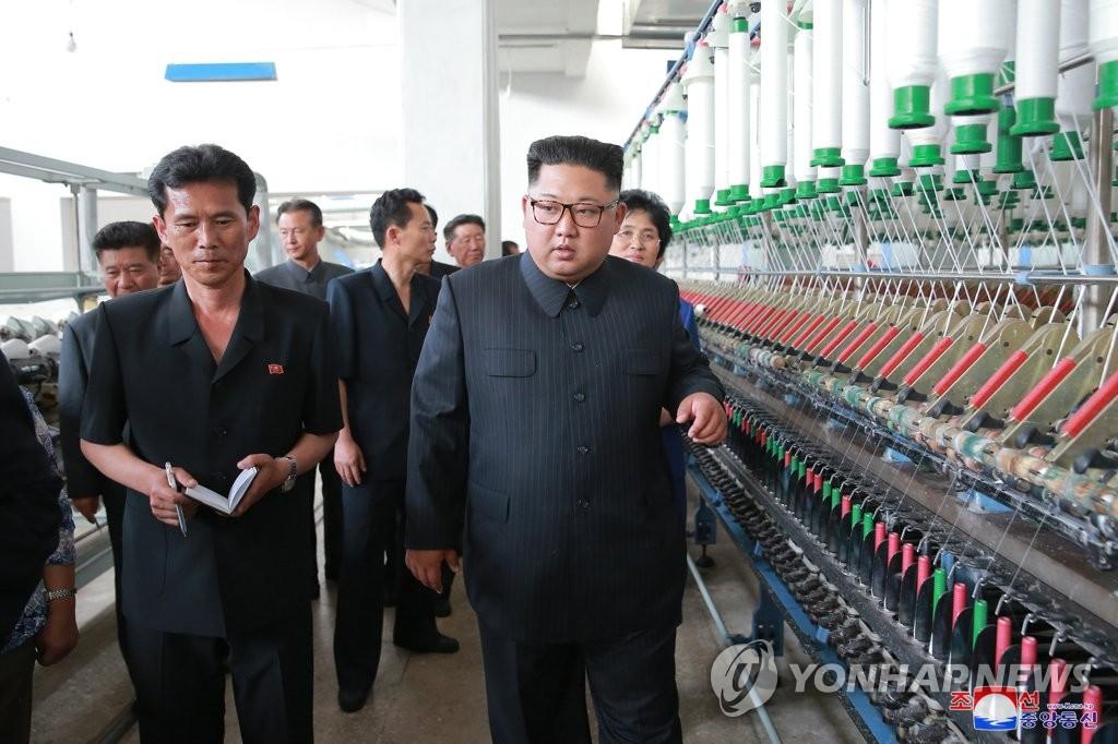 金正恩视察新义州纺织厂