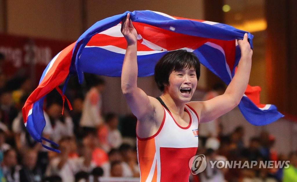 朝媒宣传国际赛事成果鼓励发展体育事业